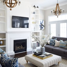 wine-barrel-chandeliers-built-in-shelving-grey-sofas-blue-and-white-spring-decor